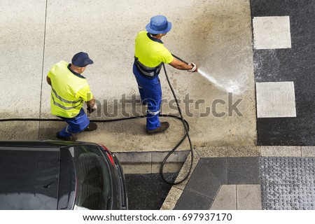 sweeper workers cleaning street road