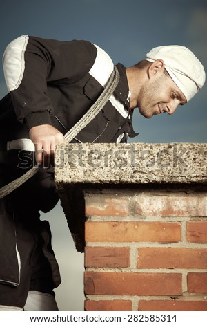 Sweeping chimney - stock photo