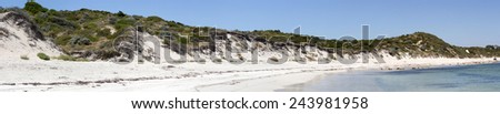 Sweeping panoramic view of the soft white sandy beach and dunes  at Hutt's beach near Bunbury Western Australia on a  early summer afternoon. - stock photo