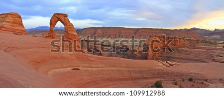 Sweeping sunset panoramic view of famous Delicate Arch in Arches National Park in Moab, Utah - stock photo