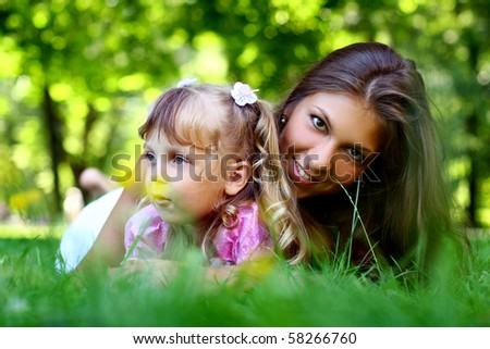 sweet and beautiful girl with her mom - stock photo