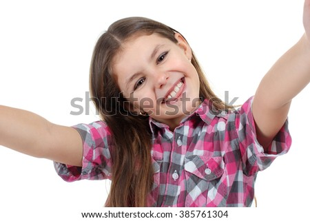 sweet and beautiful little girl in blouse making selfie isolated on white background - stock photo