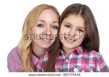 sweet and beautiful little girl near mom on white isolated background