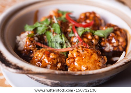 sweet and sour pork meatballs and parsley on casserole