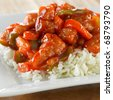 sweet and sour pork on rice - stock photo