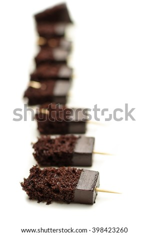 Sweet and tasty chocolate cake great for during  break on white background. - stock photo