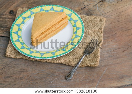 Sweet and tasty Coffee flavoured cake in dish and steel fork..  great for during coffee break - top view - stock photo