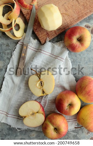 Sweet apples sliced and peeled with knife - stock photo