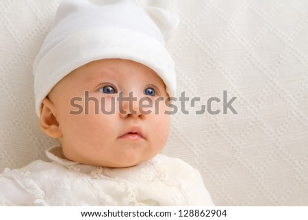 Sweet baby close up with hat - stock photo
