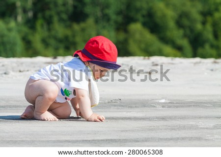 Sweet baby crawling on an untouched beach - stock photo