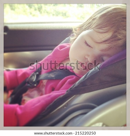 Sweet baby girl sleeping in car seat - instagram effect - stock photo