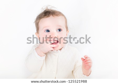 Sweet baby girl sucking on her finger