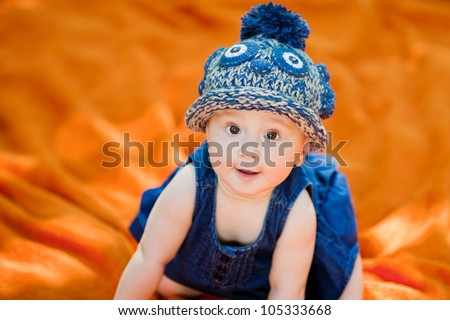 Sweet baby girl with hat - stock photo