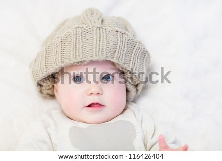 Sweet baby in a brown knitted hat - stock photo