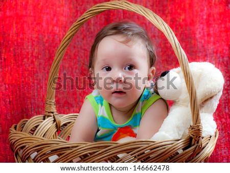 sweet baby in a wicker basket  - stock photo