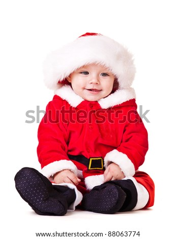 Sweet baby in red Christmas costume and Santa hat - stock photo