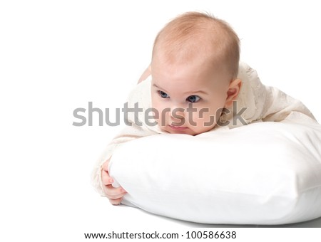 Sweet baby lying on a white pillow