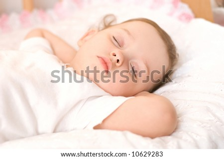 sweet baby sleeping on white blanket