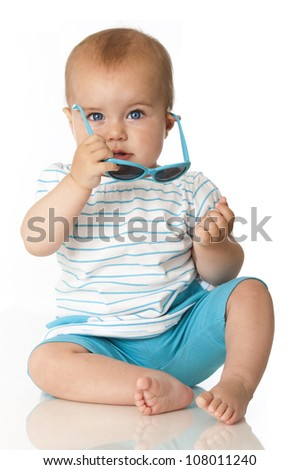 Sweet baby with sunglasses - stock photo