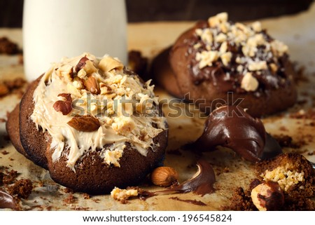 Sweet baked cookies with chocolate cream and nuts.Selective focus on the front cookie