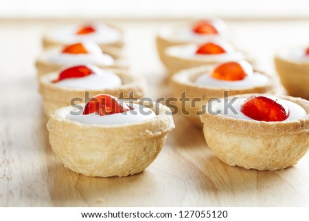 Sweet bakewell pastry treats on a table top at eye level - stock photo