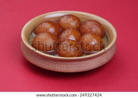 sweet balls called gulab jamun an indian sweet in a dish - stock photo