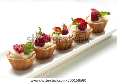 Sweet basket with cream and strawberries - stock photo