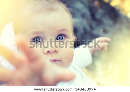 Sweet Beautiful little girl outdoors, Joyful, Happy, Excited. Closeup Headshot - stock photo