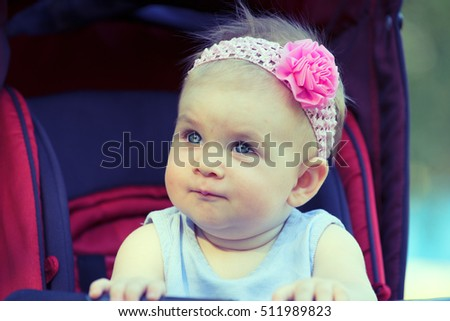 Sweet Beautiful little girl outdoors, Joyful, Happy, Excited. Closeup Headshot
