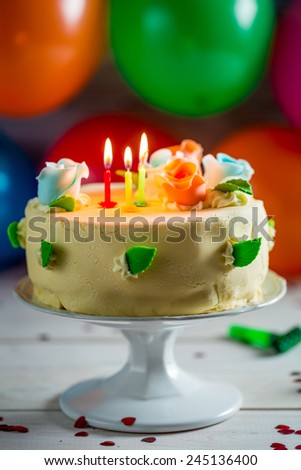 Sweet birthday cake with candles - stock photo