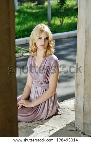 sweet blonde lady wearing dress - stock photo