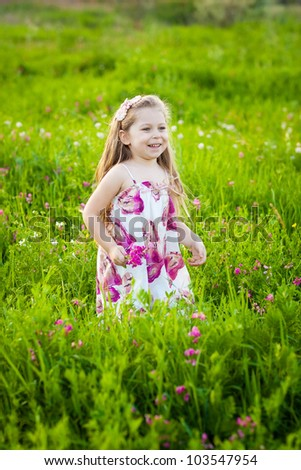Sweet blonde little girl on the meadow - stock photo