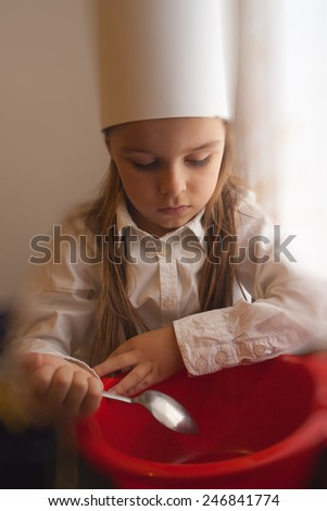 sweet boy cooks - stock photo