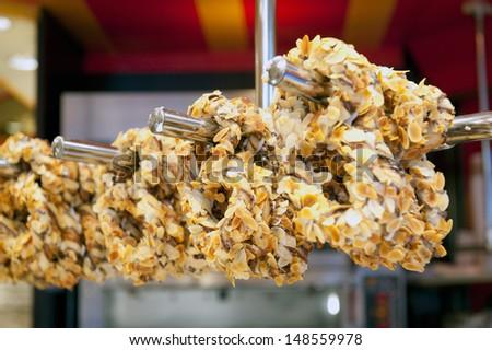 Sweet bretzel with almond - stock photo