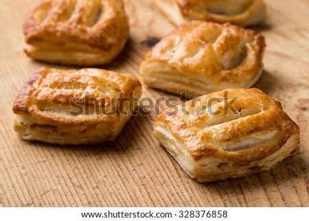sweet brown puff pastry on wooden table