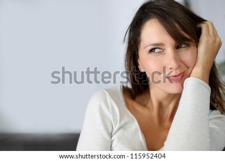 Sweet brunette woman with attractive look - stock photo