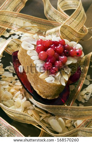 Sweet cake in heart shape - stock photo