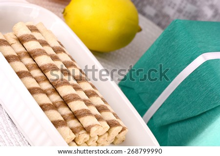 sweet cake on white plate and green gift box - stock photo