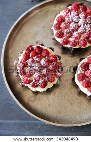 Sweet cake with raspberries on dark background - stock photo
