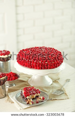 Sweet cake with raspberries on light background - stock photo