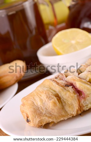 sweet cake with tea cup and lemon - stock photo