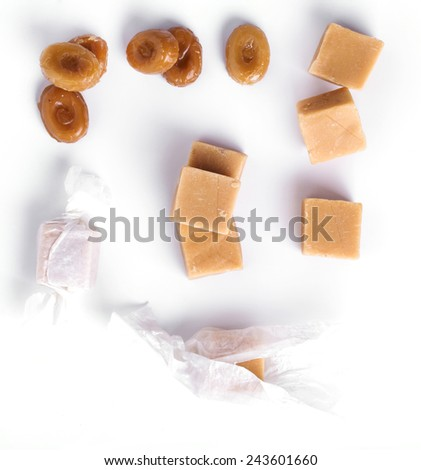 Sweet caramel candy on a white background - stock photo