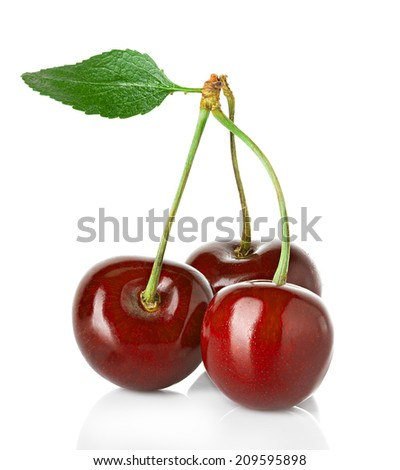 Sweet cherries with the leaf isolated on a white background.