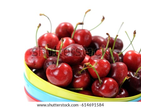sweet cherry in the bow isolated on white
