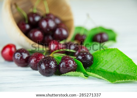 Sweet cherry on a wooden background. Background not in focus for art effect