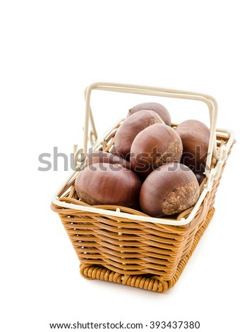 Sweet chestnut in weave basket on white background - stock photo