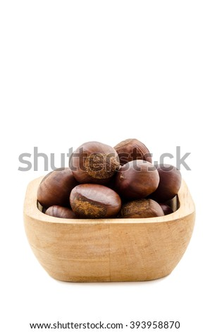 Sweet chestnut in wooden bowl on white background - stock photo