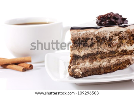 sweet chocolate cake, cinnamon sticks and coffee cup on white background