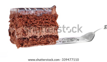 Sweet chocolate cake with spatula isolated on white background - stock photo