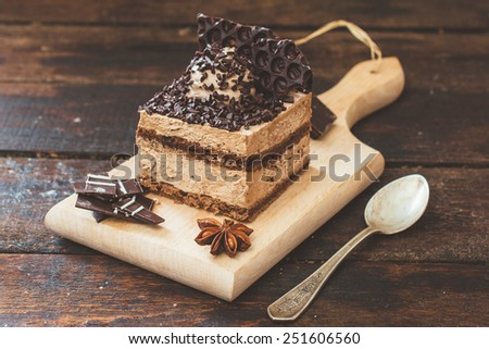 Sweet chocolate dessert on the wooden background,selective focus  - stock photo